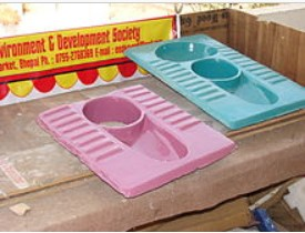 2-hole (pink) and 3-hole (blue) urine diversion ceramic squatting pan from Indian NGO EEDS. http://en.wikipedia.org/wiki/Urine-diverting_dry_toilet