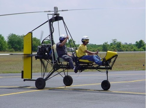 Two-seat Dominator from Rotor Flight Dynamics. The long legs of the suspension allow for very long travel for shock absorption upon landing. http://www.rotorflightdynamicsinc.com/pictures/seace001.jpg