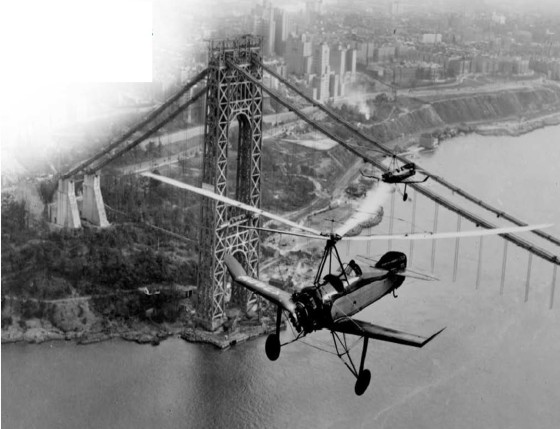 """Pitcairn PCA-2 Certification flight over George Washington bridge (under construction) November, 1930. Courtesy of Stephen Pitcairn"". Source: brochure for conference ""From Autogiro to Gyroplane: The Past, Present and Future of an Aviation Industry"", Hofstra University 2003. http://www.hofstra.edu/pdf/community/culctr/culctr_ag_regprog.pdf"